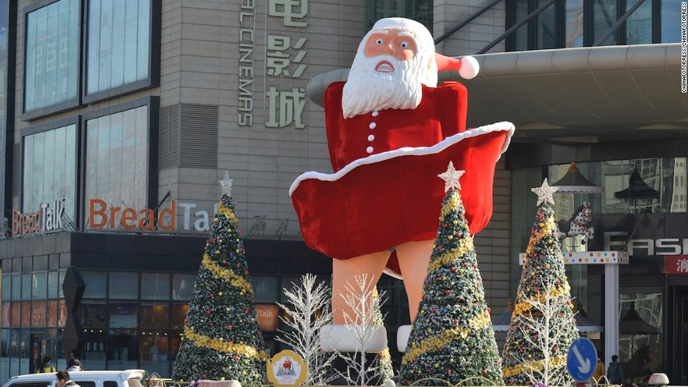 "Nothing screams ""Christmas"" quite like a wide-mouthed blowup Santa doll doing his best Marilyn Monroe ""Seven Year Itch"" impression. This beauty sits outside a mall in Taiyuan, the capital of China's northern Shanxi province."