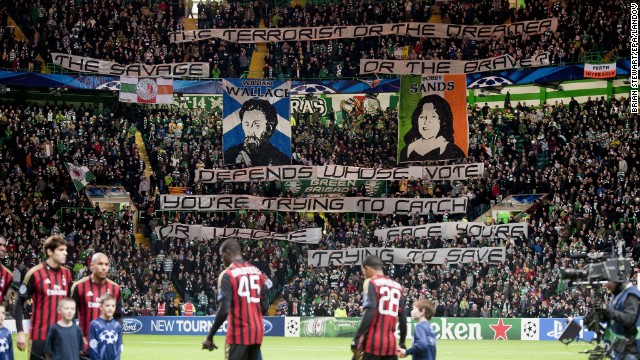 Celtic's Green Brigade fans raise banners before a game against AC Milan. The result: A fine of 50,000 euros and angry executives.