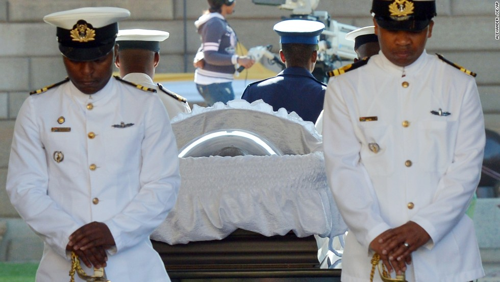 South African Naval personnel stand guard around Mandela's casket as he is carried to the Union Buildings on the final day of his lying in state on December 13.