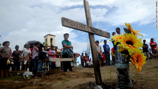 Relatives of the victims of Tyhpoon Haiyan attend a mass in Palo, Leyte on December 8, 2013.