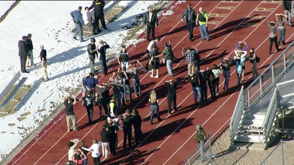 Students from Arapahoe High School gather at the school's track.