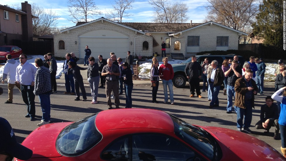 Parents wait for word about their children after a gunman opened fire at the school.