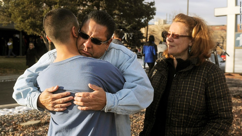Ruben Allen hugs his son Alex Allen, 17, after being evacuated from the school