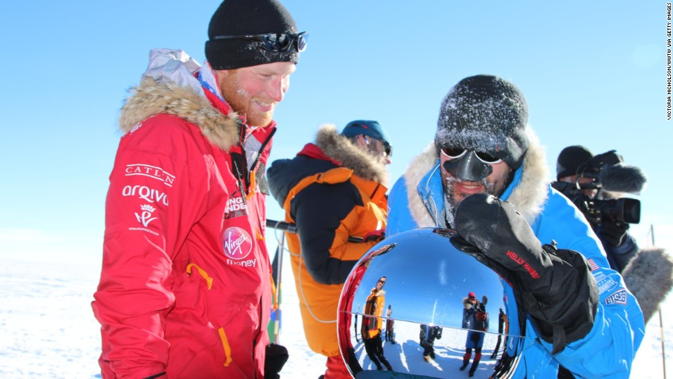 Prince Harry, Ivan Castro and their fellow adventurers reach the South Pole as part of their Walking With the Wounded charity trek on Friday, December 13, 2013, in Antarctica.