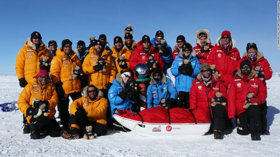Members of Team U.K., Team Commonwealth and Team U.S. pose as they reach the South Pole. The teams trekked 15 kilometers to 20 kilometers per day and endured temperatures as low as -45 C and 50 mph winds as they pulled their 70 kilogram sleds to the South Pole.
