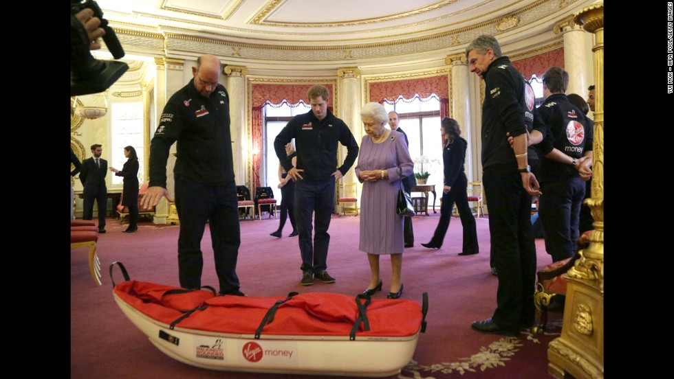 Ed Parker, left, co-founder of Walking With the Wounded and team mentor of Team USA, Prince Harry and Queen Elizabeth examine a pulk belonging to Team U.K. during a reception to meet the three teams of wounded servicemen and servicewomen.