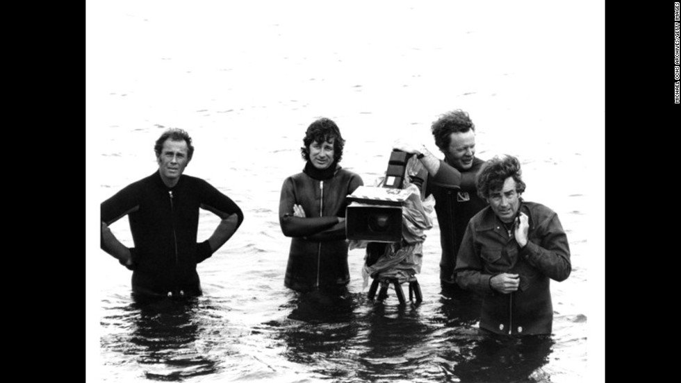 "Spielberg, arms crossed, and his camera crew wade in water on the set of ""Jaws"" at Martha's Vineyard in Massachusetts. The 1975 film made $60 million in its first month, which in 2013 dollars would be equal to about $256 million. ""Jaws"" was the highest-grossing movie of all time until ""Star Wars."""