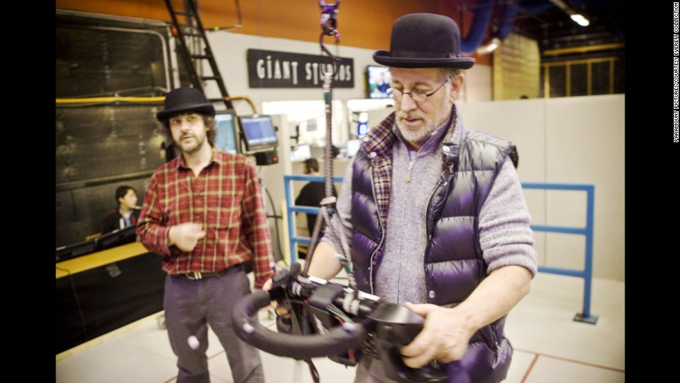 "Producer Peter Jackson, left, and Spielberg work on the set of ""The Adventures of Tintin"" in 2011. Like ""Indiana Jones,"" ""Tintin"" exists in a lost world of colonial exploration and adventure."