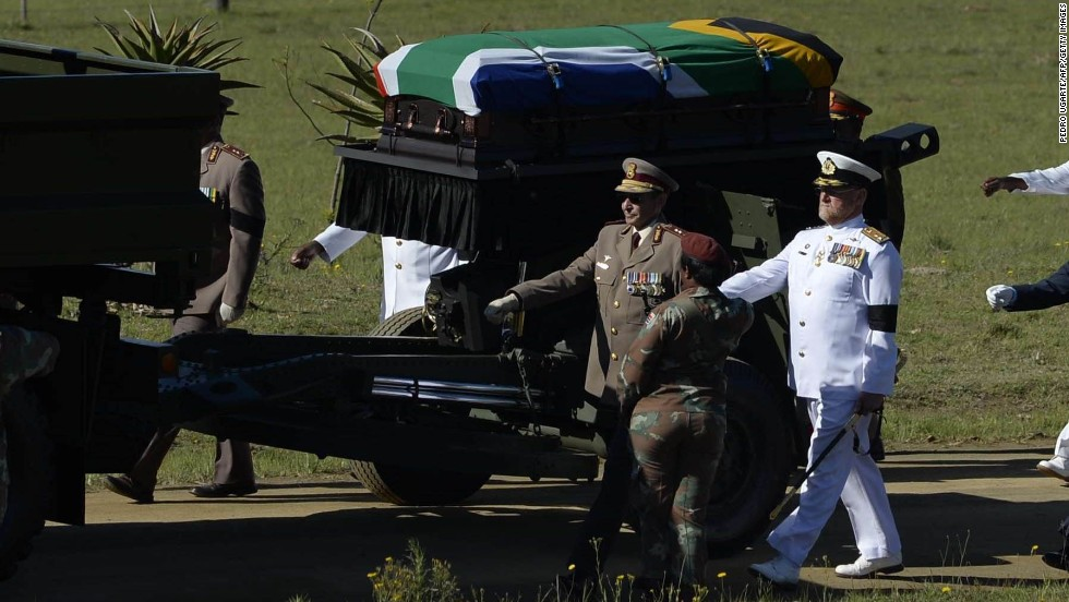 Mandela's casket is escorted to the funeral ceremony on December 15.