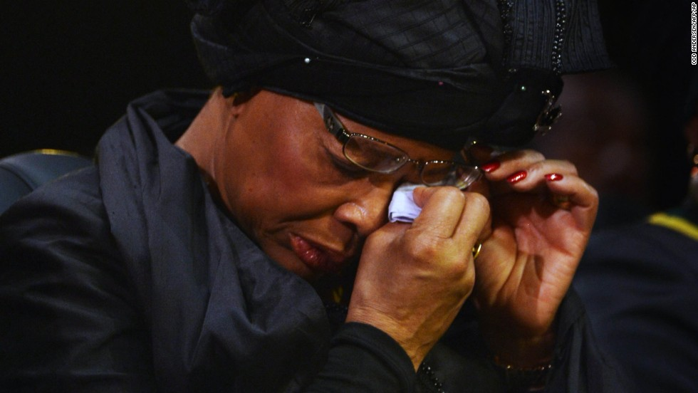 Graca Machel wipes her eyes during the ceremony.