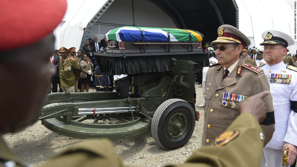 The casket leaves the funeral ceremony for burial in Qunu.