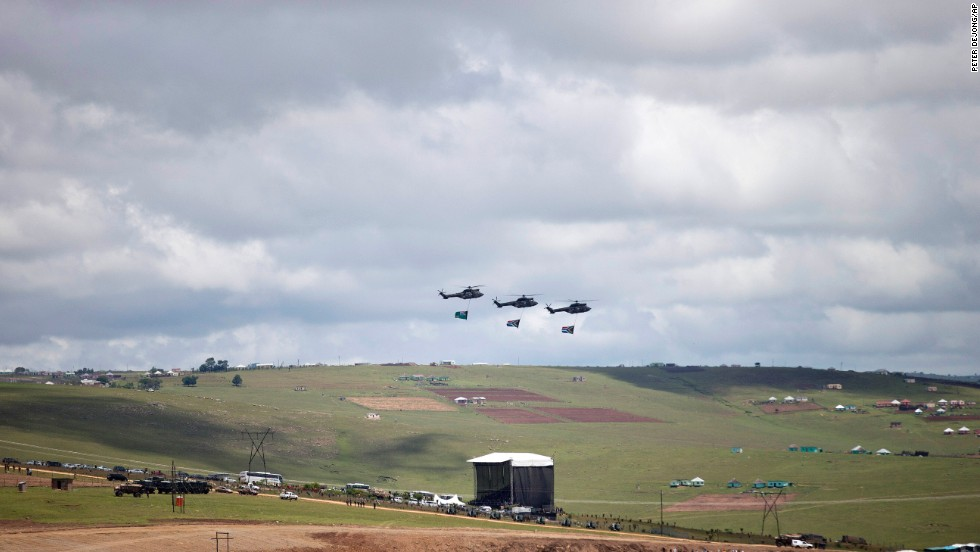 Three helicopters fly over the grave site of former South African President Nelson Mandela as his family lays his body to rest in his hometown of Qunu, South Africa, on Sunday December 15. Mandela's body traveled from Pretoria by air to Mthatha in Eastern Cape province, and then by road to Qunu, where was buried Sunday. Mandela died December 5 at his home in Houghton at the age of 95.