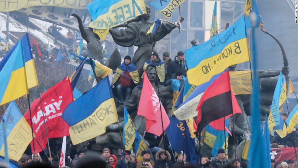 Pro-EU activists wave flags around the monument to the founders of Kiev during a rally in Independence Square on December 15.