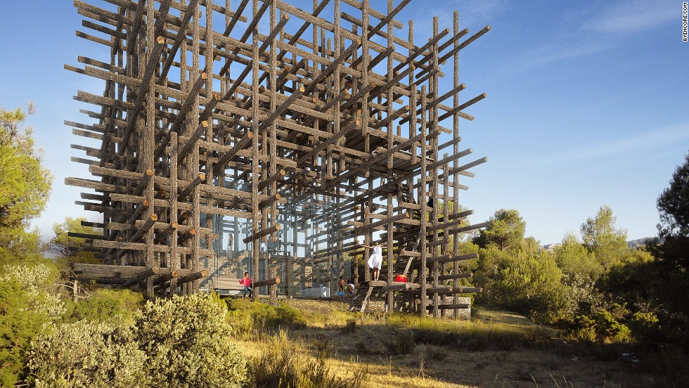 """From a distance Casa Fujimoto looks like it was constructed from match sticks. It's not far from the truth. Japanese architect <a href=""""http://www.sou-fujimoto.net/"""" target=""""_blank"""">Sou Fujimoto</a> surrounded a glass structure with tree trunks arranged in a latticework. The intention is to let the breeze circulate freely while filtering light."""