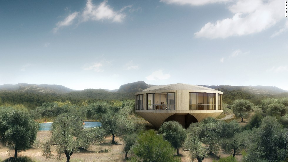 "American architects <a href=""http://www.johnstonmarklee.com/"" target=""_blank"">Sharon Johnston</a> and Mark Lee considered a guest's physical approach as they drove along the edge of the Los Puertos de Beceite nature reserve for their Casa Johnston Marklee.<br /><br />""The power of the site became the main source in imposing constraints and demands on the project,"" says Johnston. ""Responding to the panoramic landscape of the mountain range and the situation of the almond tree grove became the primary design criteria that resulted in a round-shaped house that rises above the canopies of the trees."""