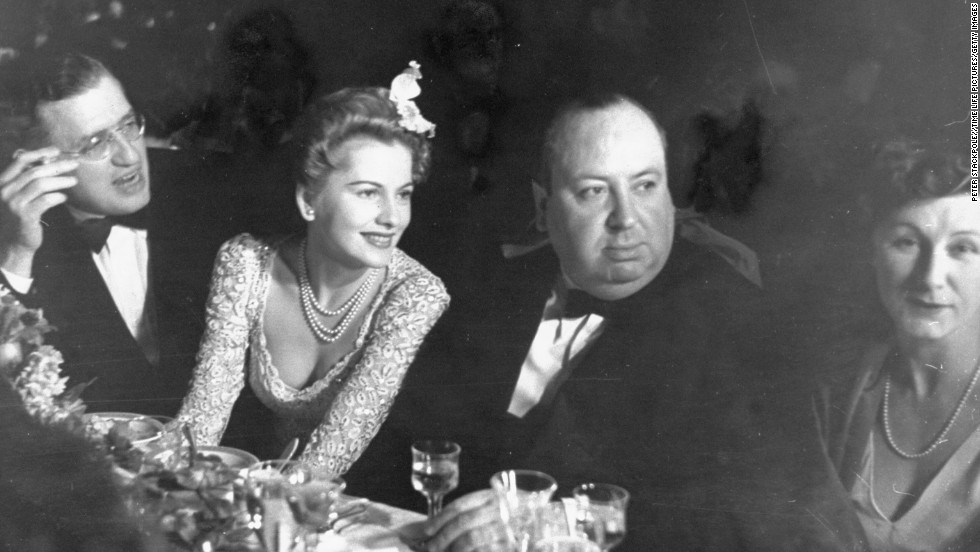 "Fontaine, second from left, sits with producer David Selznick, Hitchcock and Hitchcock's wife, Alma, at the Academy Awards presentation dinner in 1941. ""Rebecca"" won Best Picture that year."
