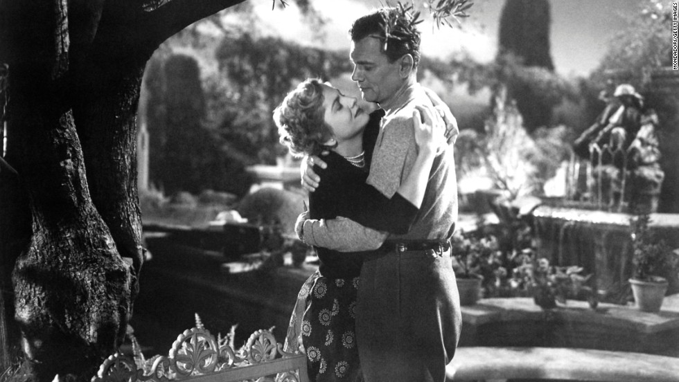 "Fontaine and Joseph Cotten act out a romantic scene from the movie ""September Affair"" in 1950."