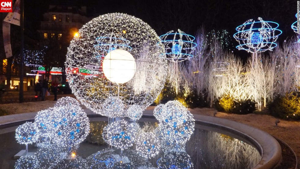 """<a href=""""http://ireport.cnn.com/docs/DOC-1065830"""" target=""""_blank"""">Erin McCormack</a> was visiting Paris during a Thanksgiving vacation with her sister and a friend when she came across this light installation. """"It definitely put me in more of a holiday spirit,"""" she says."""