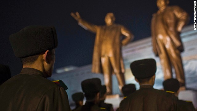 North Korean soldiers pay their respects at the base of statues of the late leaders Kim Il Sung and Kim Jong Il in Pyongyang.