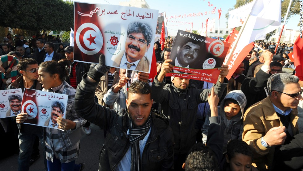 "Tunisians carry portraits of assassinated opposition figure <a href=""http://cnn.com/2013/07/25/world/africa/tunisia-politician-killed/index.html"">Mohamed Brahmi.</a>"