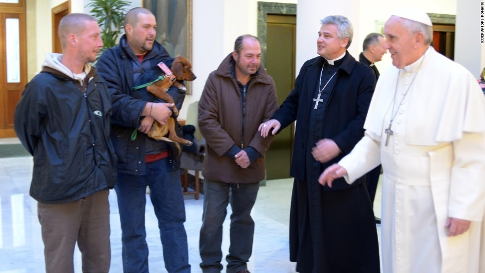 Pope Francis marked his 77th birthday in December 2013 by hosting homeless men to a Mass and a meal at the Vatican. One of the men brought his dog.