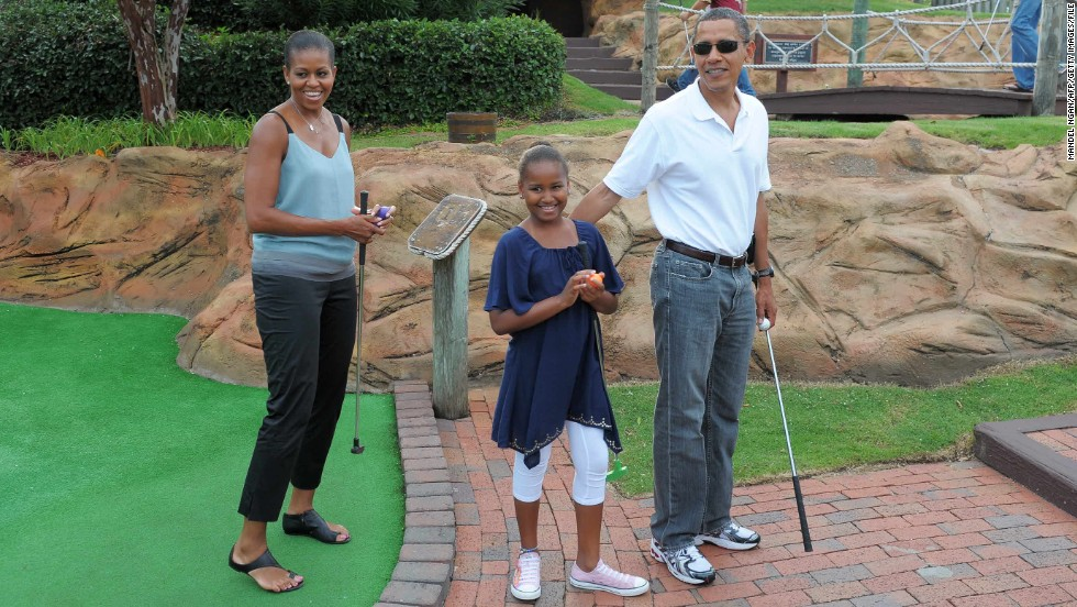 Minigolf is a popular family activity, even in the the White House -- here the Obamas take to the course in 2010. Families all over the world enjoy playing a game which gets them outdoors and, unlike conventional golf, doesn't take all day to finish.
