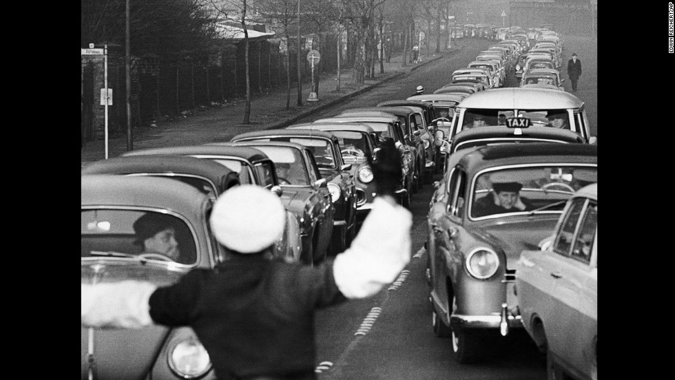 A West Berlin policeman stops traffic at an crossing point on January 5, 1964. It was the last day West Berliners could visit East Berlin with a permit, although similar holiday openings would take place during the 1960s.