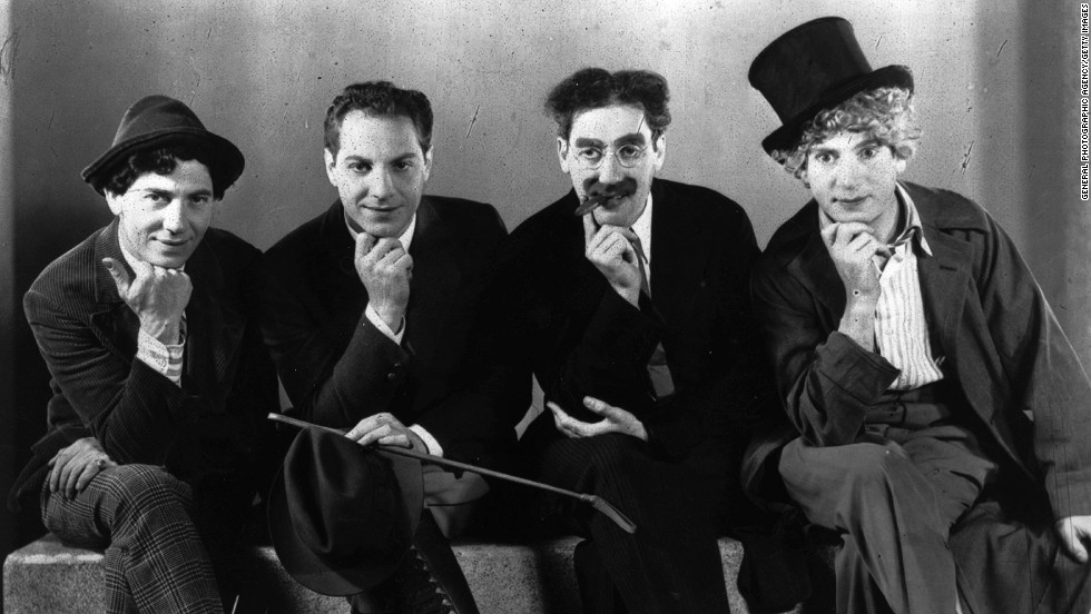 "Bringing fast-paced screwball dialogue to meet slapstick action, the <strong>Marx Brothers</strong> (from left to right  Chico, Zeppo, Groucho, Harpo) created anarchic comedy that embraced cinema's new capabilities. With a plot that is largely incomprehensible -- and doesn't really matter anyway -- <strong>""Duck Soup""<strong><em></strong> </strong></em>(1933) makes its way through slapstick set pieces and absurd exchanges of quickfire dialogue. In one scene, Groucho comes across<strong><a href=""http://www.tcm.com/mediaroom/video/115977/Duck-Soup-Movie-Clip-The-Mirror-Pantomime.html "" target=""_blank""> Harpo, dressed as him, in the frame of a broken mirror</strong></a>. The perfect execution of the mime made the mirror scene a classic."