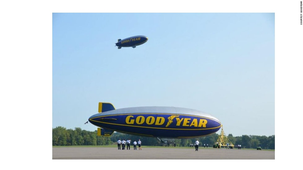 "When landing a blimp, Lussier says, ""you point the nose of the aircraft down and use power to get to the airfield."" Then ground crew members grab the blimp's rope lines and tether the airship to a mast."