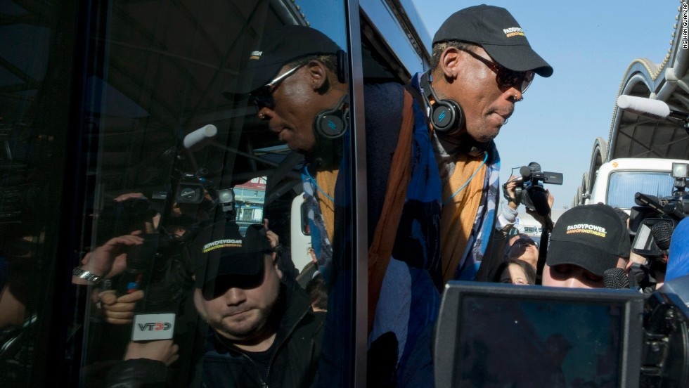 Rodman arrives at Beijing's airport before his flight to North Korea on December 19.
