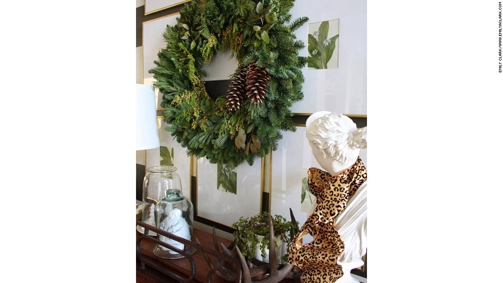 A simple wreath with pine cones and some scattered shed antlers lend a wintery air to Clark's entryway.