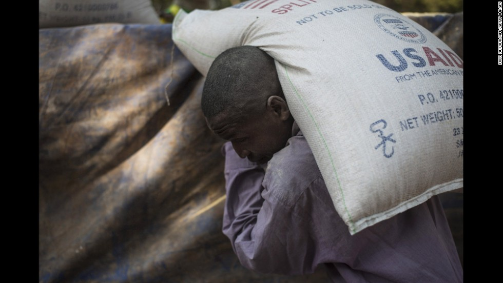 A man carries a bag of food at a Christian refugee camp in Bossangoa, Central African Republic, on December 19.