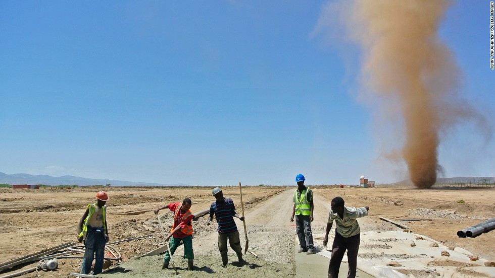 "Men work at a construction site for a new Chinese-built railway in Ethiopia in 2013. The railway will connect<a href=""http://www.erc.gov.et/index.php/projects.html?start=2"" target=""_blank""> Addis Ababa to Djibouti's Red Sea Port</a> at a cost of up to $2.8 billion. The new train line will be used for freight and passenger transport."
