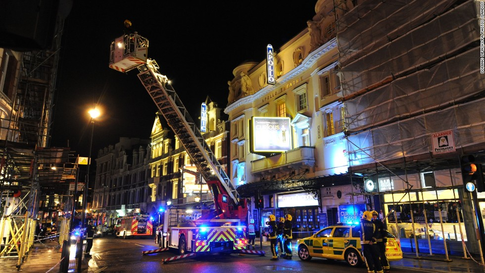 "A hydraulic lift is used to investigate the cause of the collapse. ""We heard a creak, somebody screamed, somebody from over there said, 'Look out!' and then the ceiling kind of creased in the middle and then just collapsed,"" one theatergoer said."