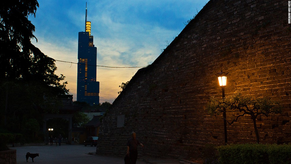 Built in the 1300s, the Ming City Wall (right) is the best preserved city wall in China. The 89-story Zifeng Tower (left) is the tallest structure in Nanjing.