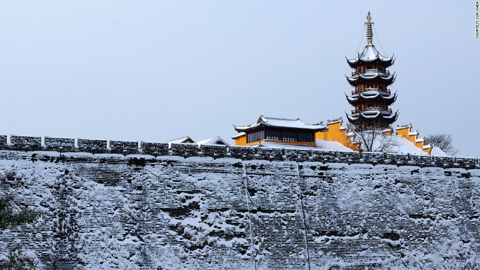 "If you aren't heading to the Plum Blossom Hill for winter shots, Ming City Wall is another photogenic spot, according to Sun. <br />""Climb up the Ming City Wall near Jiefangmen and you have a good view of Xuewu Lake and Jiming Temple as well as the wall itself."""