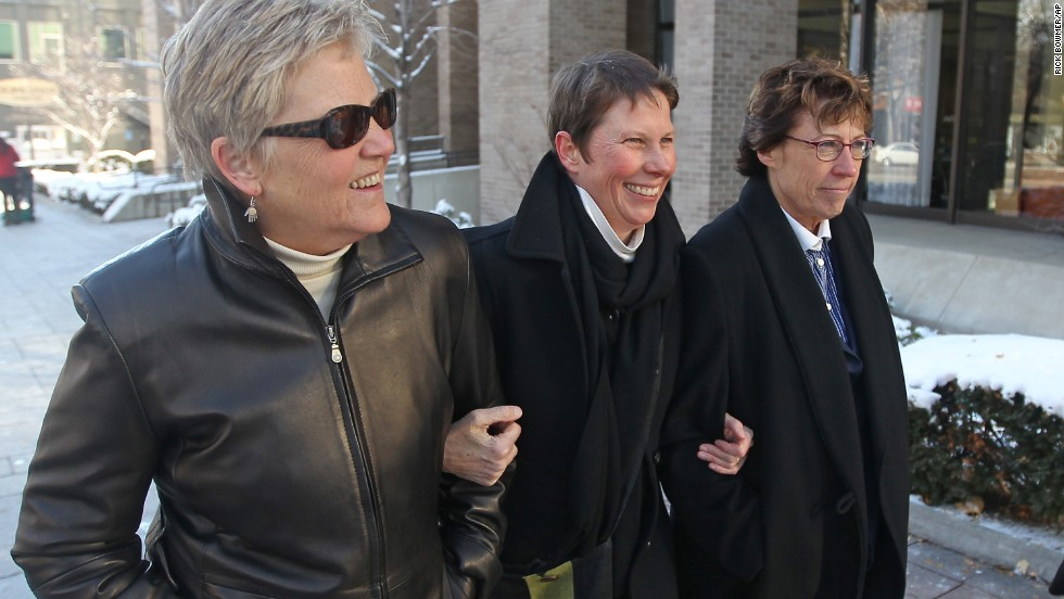 Plaintiffs Laurie Wood, left, and Kody Partridge, center, walk with attorney Peggy Tomsic on December 4, 2013, after a judge heard arguments challenging Utah's same-sex marriage ban.