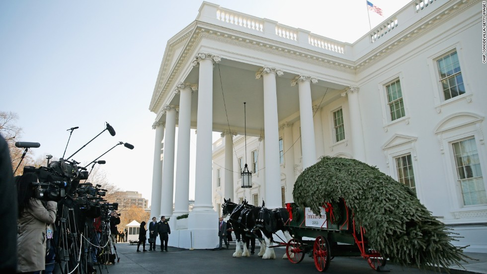 Members of the news media record the arrival of the official White House Christmas Tree at the North Portico of the White House in Washington on Friday, November 29. According to the White House, the tree, on display in the Blue Room, is an 18.5-foot Douglas fir grown by Chris Botek, a second-generation Christmas tree farmer from Lehighton, Pennsylvania.