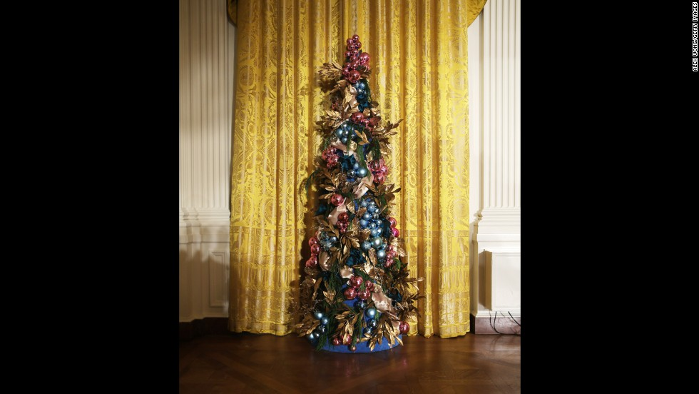 A Christmas tree stands in the East Room of the White House on Wednesday, December 4. First lady Michelle Obama hosted military families for the first viewing of the 2013 holiday decorations and demonstrated holiday crafts and treats to military children.