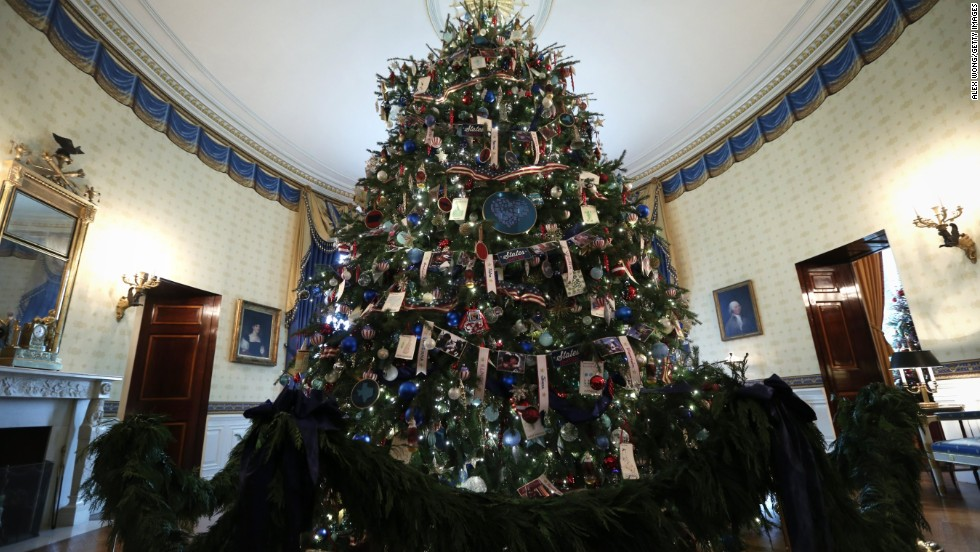 The official White House Christmas Tree stands in the Blue Room of the White House during an event to preview the 2013 holiday decorations on December 4.