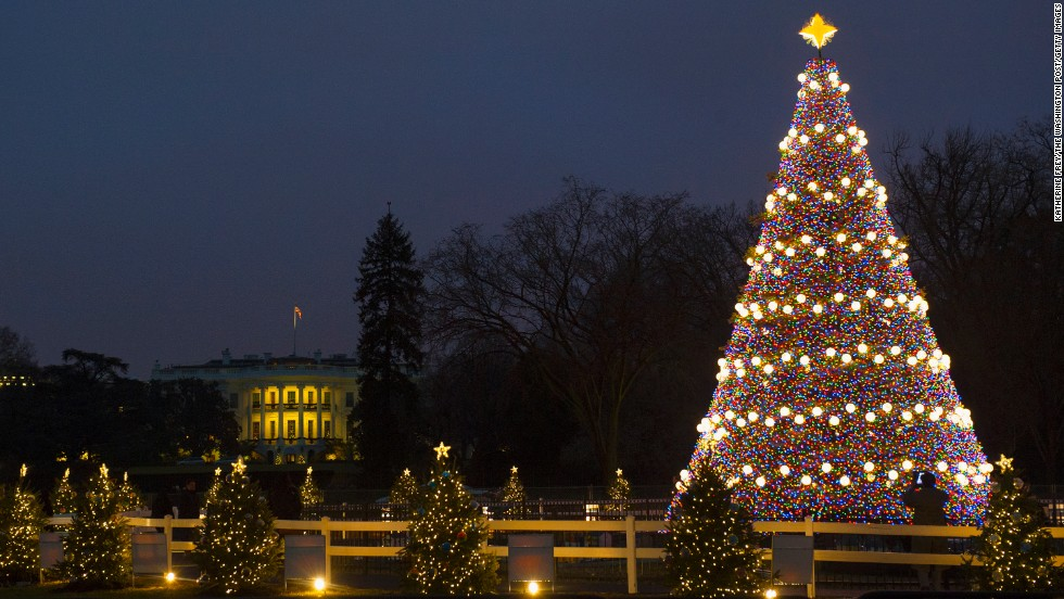 "The ""Pathway of Peace,"" 56 small, decorated trees representing all 50 states, five territories, and the District of Columbia surround the National Christmas Tree on the Elipse in front of the White House on Monday, December 9."