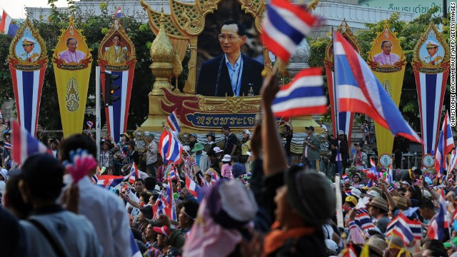 Thai anti-government protesters wave national flags as they rally in Bangkok on December 22.
