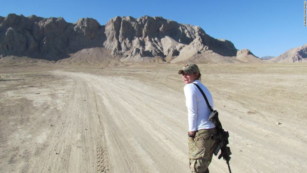 Washburn walks a trail in Afghanistan, which she called a dangerous and stressful mission.