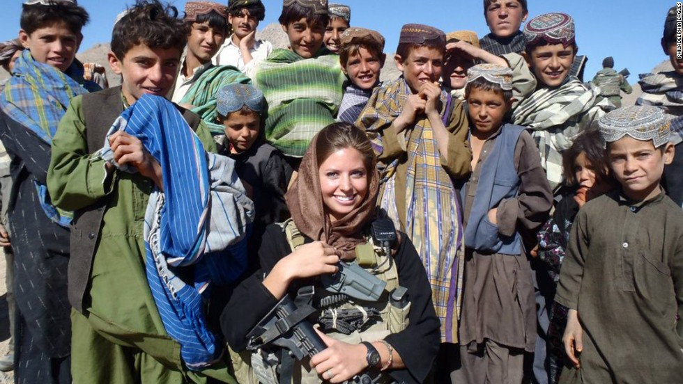 Washburn, center, worked with children and other villagers during two military tours of duty in Afghanistan.