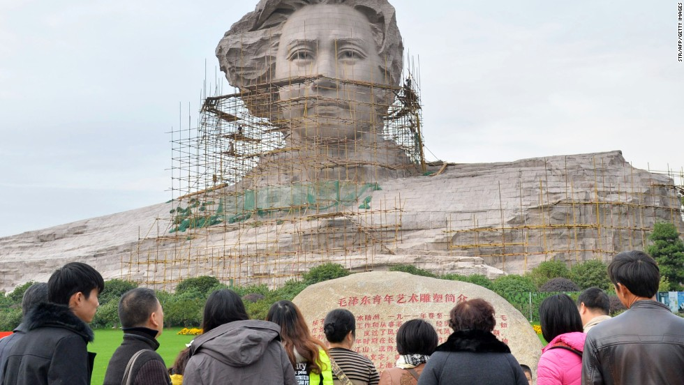 Tourists visit the statue of Mao Zedong ahead of his 120th birthday.