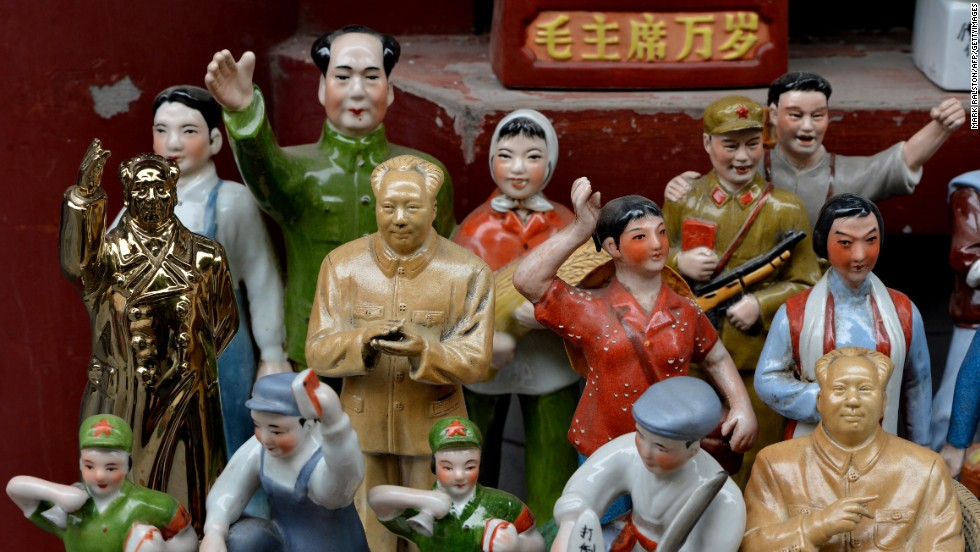 Statues of former leader Mao Zedong and figurines depicting moments in China's political history are displayed for sale at the Panjiayuan market in Beijing last year.