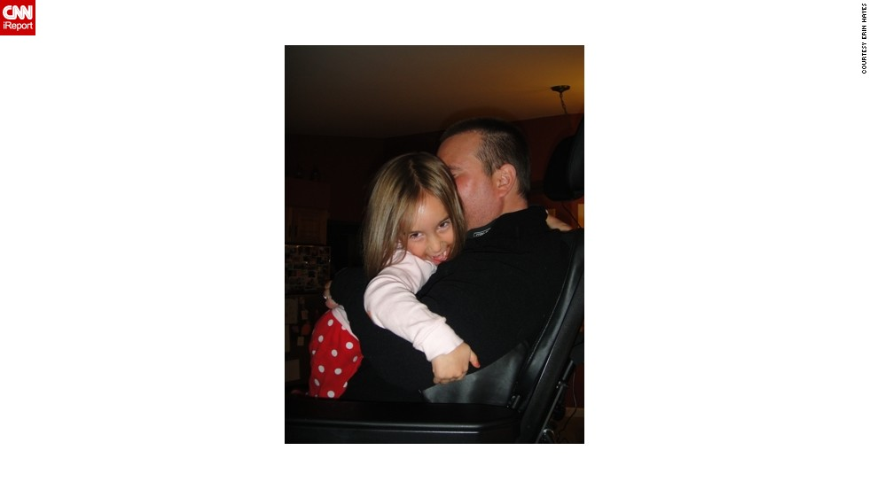 "Ben and Izzy in 2011, hugging for the first time in five years. He now has a standing chair and is able to move his left arm enough to put it around her and squeeze. ""The joy on her face says it all. I cried while taking the photo,"" Hayes said."