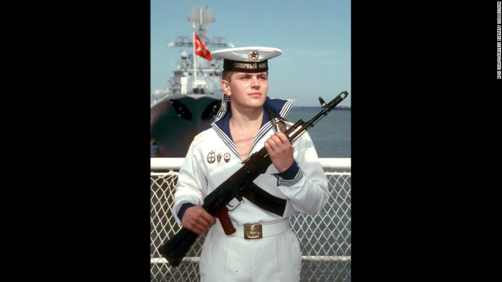 A Russian sailor stands guard with an AK-47 in Moscow during a visit from then-U.S. President Ronald Reagan in 1988.