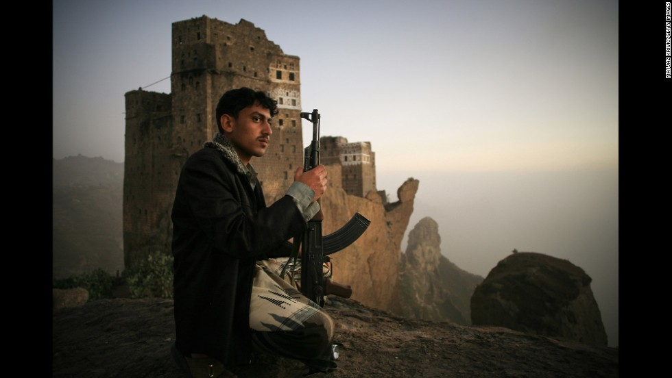 A man guards the the village of Jebel Shugruf in the Haraz Mountains of Yemen in 2006.