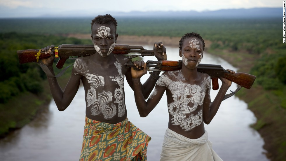 Members of the Karo Tribe pose with AK-47s in Korcho, Ethiopia, in 2008.